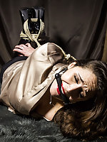Jewell is roped, hogtied and bit-gagged