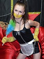 Nasty maid poses in chains and tape-gag