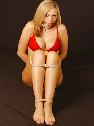 Kinky blond is ball gagged and tied up with rope