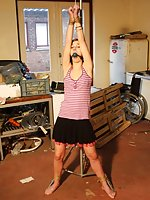 Anouk kept in place, ball-gagged, stripped, tit-grabbed