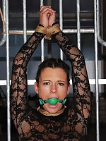 Cute brunette roped in the cage and ball-gagged