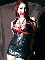 Elle tied in pvc dress and tape-gagged