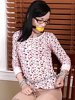 Cuffed, gagged with a big yellow bean bag gag