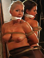 Two topless beauties bound together, cleave-gagged, tit-grabbed